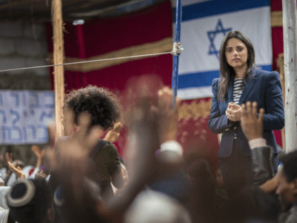 Israel's Justice Minister Ayelet Shaked speaks to members of Ethiopia's Jewish community, during a visit to a synagogue in Addis Ababa, Ethiopia Sunday, April 22, 2018. Shaked visited the synagogue in a rare visit from the high office of Israel's government and her first trip to Africa. (AP Photo/Mulugeta Ayene)