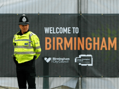 Police officers and security stand outside the perimetre around the International Convention Centre venue in Birmingham, central England, on October 1, 2016 on the eve of the start of the ruling Conservative party annual conference. Britain's ruling Conservative party will hold its annual conference at the ICC in Birmingham from …