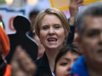 New York gubernatorial candidate Cynthia Nixon marches with activists as they rally against financial institutions' support of private prisons and immigrant detention centers, as part of a May Day protest near Wall Street in Lower Manhattan, May 1, 2018 in New York City. Across the world, people are protesting and …