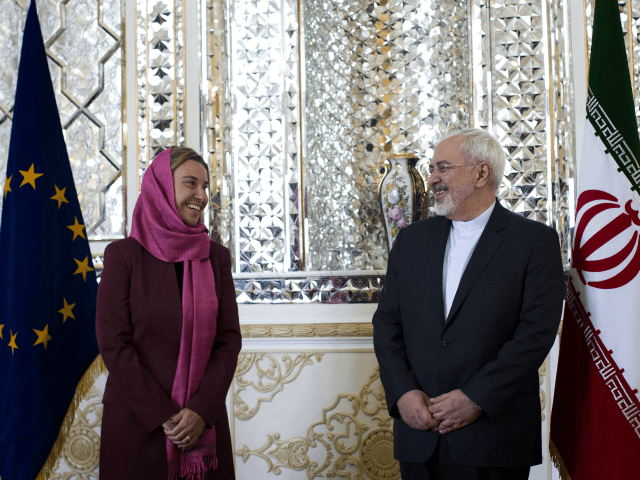 Iranian Foreign Minister Mohammad Javad Zarif (R) and EU foreign policy chief Federica Mogherini pose for a picture ahead of a joint news conference in the capital Tehran on July 28, 2015. Mogherini is in Tehran for talks on implementing this month's historic nuclear deal between Iran and the major …