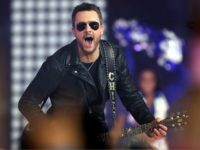 Eric Church performs during halftime of the game between the Washington Redskins and Dallas Cowboys at AT&T Stadium on November 24, 2016 in Arlington, Texas. (Photo by Tom Pennington/Getty Images)