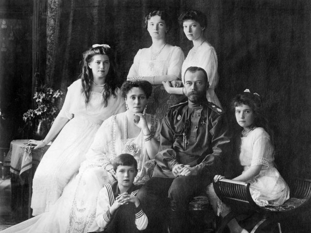 The Romanovs, the last imperial family of Russia, circa 1914, including: seated (left to right) Marie, Queen Alexandra, Czar Nicholas II, Anastasia, Alexei (front), and standing (left to right), Olga and Tatiana. (Source: Wikimedia Commons)