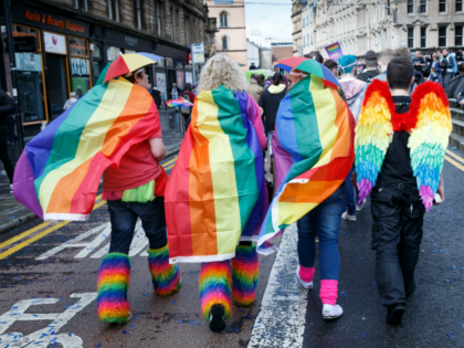 GLASGOW, SCOTLAND - AUGUST 19: Participants wear rainbow flags and angel winfs during the Glasgow Pride march on August 19, 2017 in Glasgow, Scotland. The largest festival of LGBTI celebration in Scotland has been held every year in Glasgow since 1996. (Photo by Robert Perry/Getty Images)