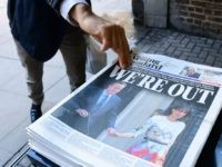 A man takes a copy of the London Evening Standard with the front page reporting the resignation of British Prime Minister David Cameron and the vote to leave the EU in a referendum, showing a pictured of Cameron holding hands with his wife Samantha as they come out from 10 …