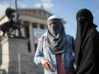 Women wearing a traditonal hijab headdress protest against Austria's ban on full-face Islamic veils in Vienna, Austria, on October 1, 2017. Austria's ban on full-face Islamic veils comes into force following similar measures in other European countries. / AFP PHOTO / APA / GEORG HOCHMUTH / Austria OUT (Photo credit …
