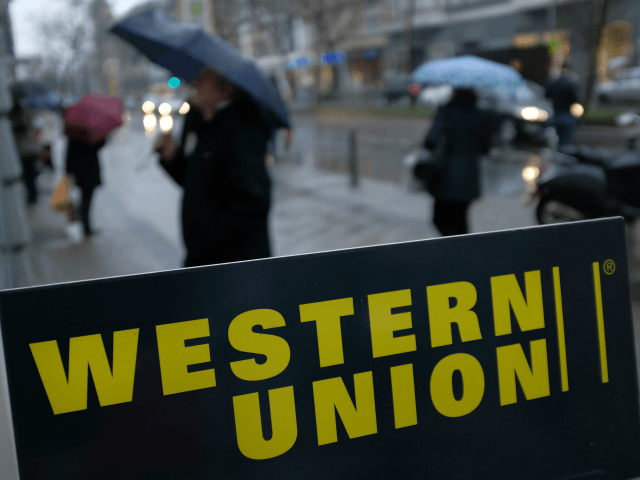BERLIN, GERMANY - JANUARY 11: A sign advertises the money transfer service Western Union on January 11, 2018 in Berlin, Germany. Much of the German financial services, consumer goods and foodstuffs economy is dominated by nationwide chains and brands. (Photo by Sean Gallup/Getty Images)