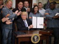 WASHINGTON, DC - MARCH 08: Surrounded by applauding steel and aluminum workers, U.S. President Donald Trump holds up the 'Section 232 Proclamations' on steel imports that he signed in Roosevelt Room the the White House March 8, 2018 in Washington, DC. Trump announced last week that he will put a …