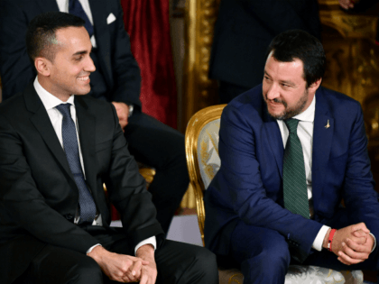 Italys Labor and Industry Minister and deputy PM Luigi Di Maio (L) and Italys Interior Minister and deputy PM Matteo Salvini smile before the swearing in ceremony of the new government at Quirinale Palace in Rome on June 1, 2018. - Italian cabinet members of the new government led by …