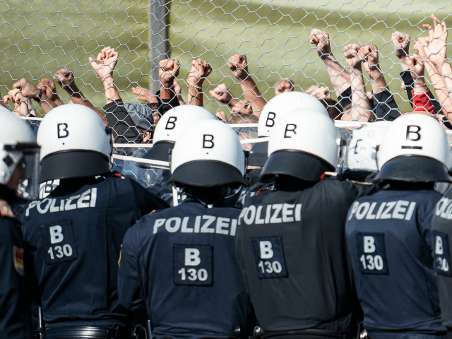 New border patrol police unit called Puma as well as performers of 'strangers' take part in the exercise 'ProBorders' at the Spielfeld border crossing in Austria on June 26, 2018. - Several hundred Austrian police and soldiers on June 26, 2018 simulated a border control exercise at the crossing point …