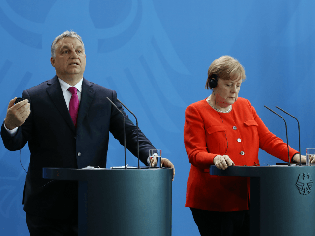 BERLIN, GERMANY - JULY 05: German Chancellor Angela Merkel and Hungarian Prime Minister Viktor Orban speak to the media following talks at the Chancellery on July 5, 2018 in Berlin, Germany. Germany recently reached a compromise within its government over migration policy. (Photo by Sean Gallup/Getty Images)