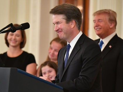 Supreme Court nominee Brett Kavanaugh speaks while his wife Ashley Estes Kavanaugh (L) and US President Donald Trump listens after the announcement of his nomination in the East Room of the White House on July 9, 2018 in Washington, DC. (Photo by MANDEL NGAN / AFP) (Photo credit should read …