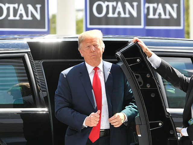 US President Donald Trump (C) arrives to attend the NATO (North Atlantic Treaty Organization) summit, in Brussels, on July 11, 2018. (Photo by EMMANUEL DUNAND / AFP) (Photo credit should read EMMANUEL DUNAND/AFP/Getty Images)