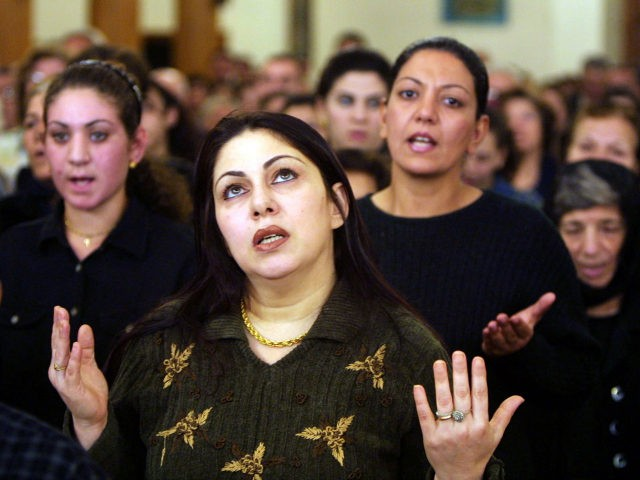 Iraqi Christians pray in a church, as all Christian denominations in Iraq prayed to prevent war on Iraq November 22, 2002 in Baghdad, Iraq. NATO members have declared themselves united in backing U.N. efforts to rid Iraq of weapons of mass destruction, but the 19-nation defense alliance stopped short of …