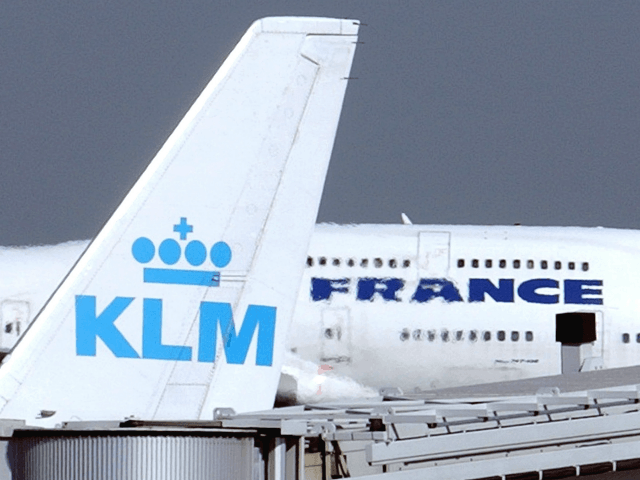 In this Sept. 30, 2003 file photo, an Air France jumbo jet rolls behind the tail of a KLM Royal Dutch airliner at Charles de Gaulle airport in Roissy, north of Paris. KLM said Wednesday, Sept. 14, 2016 that it will temporarily suspend flights to and from Cairo in January, …