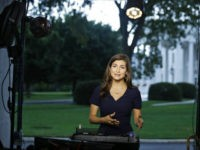 CNN White House correspondent Kaitlan Collins talks during a live shot in front of the White House, Wednesday, July 25, 2018, in Washington. Collins says the White House denied her access to President Donald Trump's Rose Garden statement with the European Union Commission president because officials found her earlier questions …