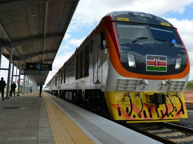One of Kenya's newly acquired standard gauge rail locomotive, carrying Kenyan President pulls into Voi railway station on May 31, 2017 in Voi, during an inaugural ride on Kenya's new standard gauge railway from the coastal city of Mombasa to the capital, Nairobi. Kenya's President Uhuru Kenyatta on Wednesday inaugurated …