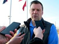 Kansas Secretary of State Kris Kobach answers questions from reporters after announcing his pick for a running mate in the Kansas governor's race, Wednesday, March 21, 2018, in Topeka, Kan. His running mate is Wichita businessman Wink Hartman, a former rival in the GOP race.