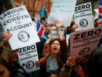 LONDON, ENGLAND - APRIL 08: Campaigners from the Campaign Against Antisemitism demonstrate and listen to speakers outside the Labour Party headquarters on April 8, 2018 in London, England. Protesters are calling on Labour's hierarchy to 'hold Jeremy Corbyn to account' after claims that he and the party are not doing …