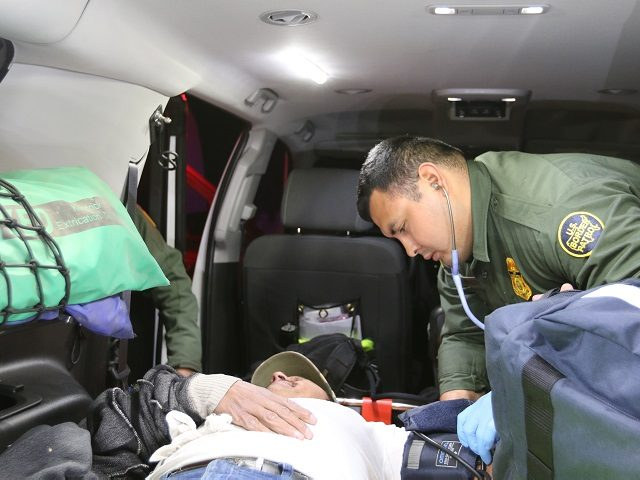 A Laredo Sector Border Patrol agent administers life-saving fluids to an illegal alien suffering from the Texas heat. (Photo: U.S. Border Patrol/Laredo Sector)