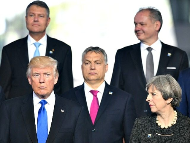Leaders Meet For NATO Summit BRUSSELS, BELGIUM - MAY 25: US President Donald Trump (front left) and Prime Minister Theresa May (front right) during the North Atlantic Treaty Organisation (NATO) summit on May 25, 2017 in Brussels, Belgium.