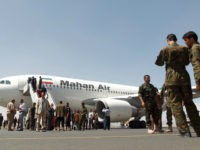 An airplane of Mahan Air sits at the tarmac after landing at Sanaa International Airport in the Yemeni capital on March 1, 2015 a day after officials from the Shiite militia-controlled city signed an aviation agreement with Tehran. Western-backed President Abedrabbo Mansour Hadi, who fled last weekend an effective house …