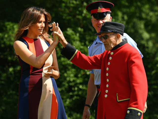 LONDON, ENGLAND - JULY 13: First Lady, Melania Trump, high-fives a Chelsea Pensioners as she tries her hand at bowls as she meets British Army veteransat Royal Hospital Chelsea on July 13, 2018 in London, England. First Lady, Melania Trump, visited the Chelsea Pensioners while her husband, President Donald Trump, …