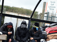 Migrants live in a park in the Belgian port city of Zeebrugge, on February 4, 2016. Some migrants are heading to the Belgian coast, to try and smuggle themselves on bound ferries to reach Britain. Belgian police are cracking down on migrants arriving in Zeebrugge, with more than 450 people …