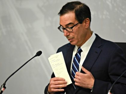 U.S. Treasury Secretary Steven Mnuchin puts away his notes during a press conference at the G20 meeting of Finance Ministers and Central Bank governors in Buenos Aires, Argentina, Sunday, July 22, 2018. G-20 finance ministers and central bank chiefs are meeting in Buenos Aires amid fears over U.S. President Donald …