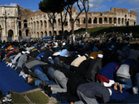 Muslim men attend Friday prayers near Rome's ancient Colosseum on October 21, 2016 to protest against the closure of unofficial mosques. The Muslim community of Rome gathered by the Colosseum to pray and demonstrate against the alleged shutting down by police of unofficial mosques. / AFP / GABRIEL BOUYS (Photo …