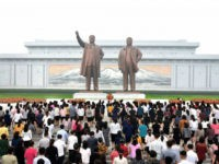 This picture taken and released from North Korea's official Korean Central News Agency (KCNA) on September 9, 2017 shows North Korean residents offering flowers before the statues of Kim Il-Sung and Kim Jong-Il (R) on Mansu Hill in Pyongyang during celebrations of the 69th anniversary of North Korea's national day. …