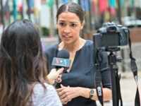 "Alexandria Ocasio-Cortez, a winner of a Democratic Congressional primary in New York speaks to a reporter, Wednesday, June 27, 2018, in New York. The 28-year-old political newcomer who upset U.S. Rep. Joe Crowley in New York's Democrat primary says she brings an ""urgency"" to the fight for working families."