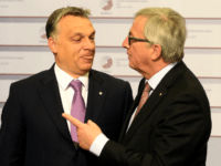 Hungarian Prime Minister Viktor Orban is greeted by President of the European Commission Jean-Claude Juncker on the second day of the fourth European Union (EU) eastern Partnership Summit in Riga, on May 22, 2015 as Latvia holds the rotating presidency of the EU Council. EU leaders and their counterparts from …