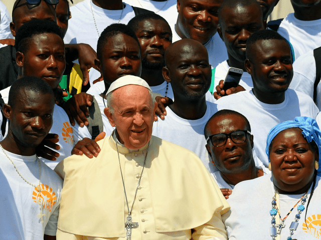 TOPSHOT - Pope Francis poses for photographs during a meeting with a group of migrants at his weekly audience in St. Peter's square at the Vatican for on on June 6, 2018. (Photo by TIZIANA FABI / AFP) (Photo credit should read TIZIANA FABI/AFP/Getty Images)