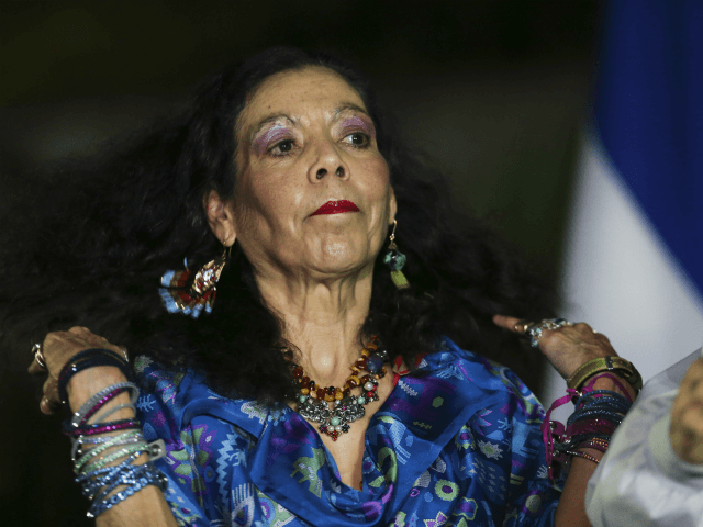 Nicaragua's first lady and vice presidential candidate Rosario Murillo looks on during a short talk to the media and supporters after casting her ballot in Managua, Nicaragua, Sunday, Nov. 6, 2016. President Daniel Ortega appears headed for a a third consecutive term victory in the general election, but critics accused …