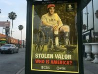 'Stolen Valor': Street Artist Hits Sacha Baron Cohen Over Prank Interview With Sarah Palin