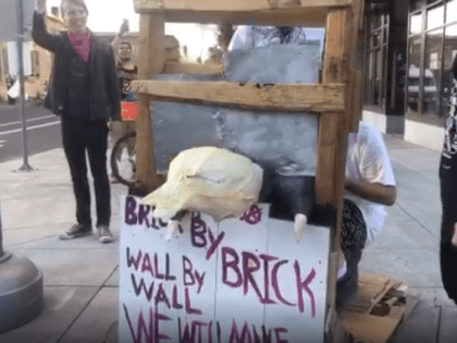 Abolish ICE Activists Execute 'Donald Trump' with Guillotine