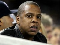Entertainment mogul Jay-Z watches the New York Yankees play against the Texas Rangers in Game Three of the ALCS during the 2010 MLB Playoffs at Yankee Stadium on October 18, 2010 in New York, New York. (Photo by Nick Laham/Getty Images)