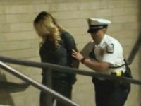 In this frame from video, porn actress Stormy Daniels is led into jail in Columbus, Ohio., after being taken into custody during a Wednesday evening, July 11, 2018, show. Daniels was arrested at a strip club and is accused of letting patrons touch her in violation of a state law, …