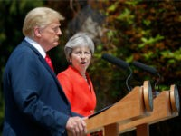 British Prime Minister Theresa May, center, looks over toward President Donald Trump during their joint news conference at Chequers, in Buckinghamshire, England, Friday, July 13, 2018. (AP Photo/Pablo Martinez Monsivais)