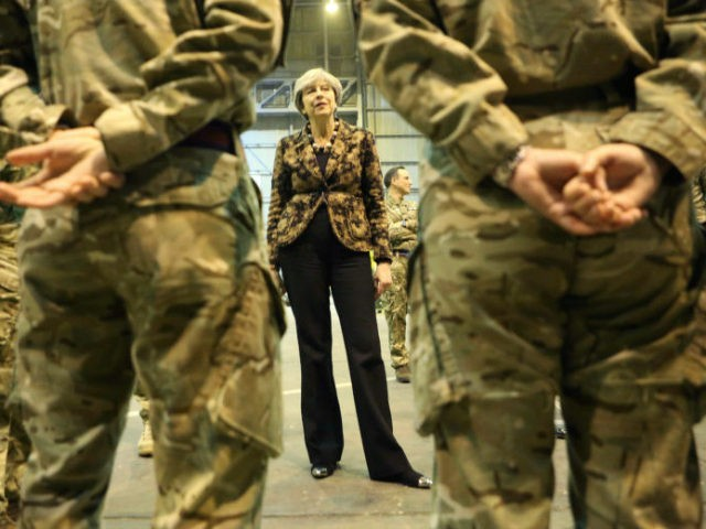British Prime Minister Theresa May speaks with troops serving at RAF Akrotiri, one of two military bases Britain maintains on the east Mediterranean island of Cyprus on Thursday, Dec. 21, 2017. May stopped off at RAF Akrotiri to deliver good wishes to service personnel for the upcoming holidays on her …