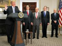 President Trump announces tariffs on steel and aluminum earlier this month, flanked by Steven Mnuchin, Wilbur Ross, Robert Lighthizer, and Peter Navarro.