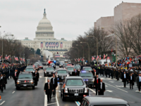 With Capitol Hill in the background, President Donald Trump and the first family ride in a motorcade during the inaugural parade in Washington, Friday, Jan. 20, 2017, after Donald Trump was sworn in as the 45th president of the United States.