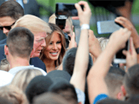 Trump July Fourth President Donald Trump, accompanied by first lady Melania Trump, greets military families during an afternoon picnic on the South Lawn of the White House, Wednesday, July 4, 2018, in Washington.