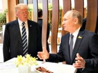 HAMBURG, GERMANY - JULY 07: In this photo provided by the German Government Press Office (BPA), Donald Trump, President of the USA (C) meets Vladimir Putin, President of Russia during the G20 Summit on July 7, 2017 in Hamburg, Germany. The G20 group of nations are meeting July 7-8 and …
