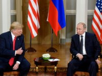 U.S. President Donald Trump, left and Russian President Vladimir Putin talk during their meeting in the Presidential Palace in Helsinki, Monday, July 16, 2018. Trump and Putin arrived Monday at Helsinki's presidential palace for a long-awaited summit, hours after Trump blamed the United States, and not Russian election meddling or …