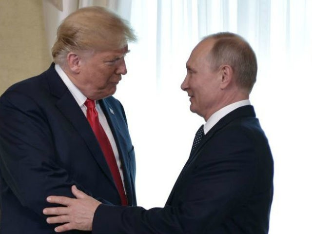 US President Donald Trump (C) shakes hands with Russia's President Vladimir Putin next to US First Lady Melania Trump (L) ahead a meeting in Helsinki, on July 16, 2018. - The US and Russian leaders opened an historic summit in Helsinki, with Donald Trump promising an 'extraordinary relationship' and Vladimir …