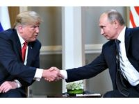 Russian President Vladimir Putin (R) and US President Donald Trump shake hands before a meeting in Helsinki, on July 16, 2018.