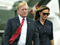 President Donald Trump and first lady Melania Trump walk from Marine One to board Air Force One at Morristown Municipal Airport, in Morristown, N.J., Sunday, July 22, 2018, en route to Washington after staying at Trump National Golf Club in Bedminster, N.J.