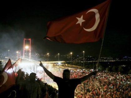 Citizens wave Turkish Flags during a march towards July 15 Martyrs' Bridge to protest Parallel State/Gulenist Terrorist Organization's failed military coup attempt and to show solidarity with the Turkish government in Istanbul, Turkey on July 21, 2016. Parallel State is a terrorist organization leaded by U.S.-based cleric Fetullah Gulen, who …