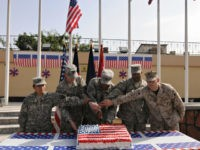 US soldiers cut a cake in celebration of the 4th of July, the US Independence Day, on July 4, 2009. US President Barack Obama has made Afghanistan the centre-piece of his foreign policy, dispatching an extra 21,000 American troops as part of a sweeping new war plan to stabilise the …